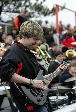 Nick Pantazi, a junior and a member of the Ipswich High School band, plays along with the band before the start of the Thanksgiving football game against Hamilton-Wenham. Photo by Deborah Parker/November 26, 2009