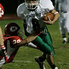Boxford: Pentucket's Jordan Silva escapes the tackle by Masconomet's Damian Bandereck during last night's game held at Masco. Photo by Deborah Parker/Salem News Friday, November 7, 2008.