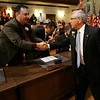 City Councilor Ted Bettencourt shakes hands with Mayor Micheal Bonfanti during last nights inauguration held at Wiggins Auditorium at City Hall. Photo by Deborah Parker/January 4, 2009