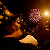 Salem: Halloween revelers watch the fireworks finale marking the end of the Halloween Celebration. Photo by Deborah Parker/Salem News Friday, October 31, 2008.
