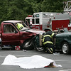 "Members of Beverly High School peer leadership team along with the Police and Fire departments simulate an after party car crash in a parking lot at the school Wednesday. In preperation for prom the mock crash was held to encourage students to realize what could happen if they drink and drive after prom or any event. In the foreground peerd leader, Thyra Rollins lays on the ground while fellow leader, Erin Bushey is pulled from a car during the ""crash"". Photo by Deborah Parker/June 10, 2009"