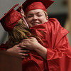 Valedictorian Maureen Regan embraces Margaret Duffy after a tearful introduction before her valedictory speech during graduation at Salem High School Friday evening. Photo by Deborah Parker/June, 5, 2009