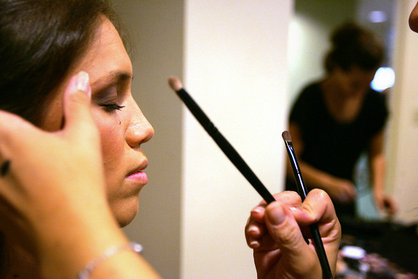 Ashley Shultz of Beverly has her makeup applied before the start of the Lorraine Roy Designer Collections and Bridal Boutique's Pink Pumps and Polka Dots fashion show held at Putnam Farm in Danvers Wednesday evening. Photo by Deborah Parker/August 19, 2010