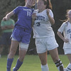 Danvers' Brittany Russo and Peabody's Casey Broughton both head the ball while trying to gain control of the ball during Wedensday afternoon's game held in Peabody. Photo by Deborah parker/september 29, 2010