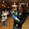 "Kim Fogelgren of Beverly dances with her 18 month old son, Sam, during ""Ciao Centerville, Chow Pizza"" a fundraiser for the Centerville PTO held at the Vittori Rocci Post Friday evening. Photo by Deborah Parker/April 9, 2010"