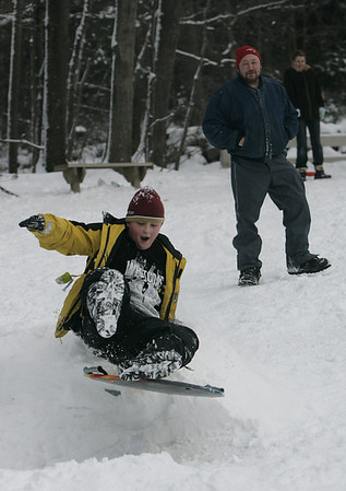 Danvers:Jake Shairs, 11, of Danvers makes his way over a jump after getting a big push from Ed Henry of Danvers, while sledding at Endicott Park yesterday afternoon. The park was busy with kids and families sledding as well as others cross country skiing around the property. <br /> Photo by Deborah Parker/Salem News Sunday, January 11, 2009