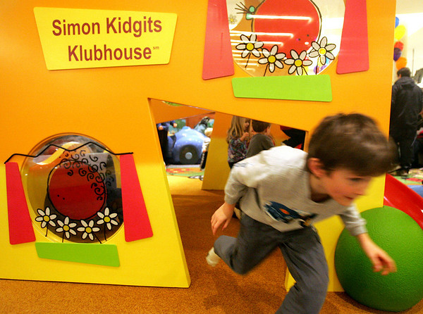Sully Watts, 7, of Danvers runs through the new Children's Area in front of the Macy's Men's and Furniture wing at the North Shore Mall Saturday during the new play area's grand opening.  Photo by Deborah Parker/November 14, 2009