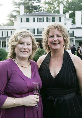 Keelin Dawe, chairwoman of Danvers Family Festival and fellow board member Sheryl James pose together while attending the annual Baron Mayor Champagne Reception held at the Glen Magna Farms in Endicott Park Friday evening. Photo by Deborah Parker/June 19, 2009