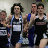 From left, Peabody's TJ D'Amato and Nick Christianson along with Danver's Chris Chapruet and Marblehead's Tucker Reece compete in the 2 mile during yesterday's NEC Championship meet held at the Reggie Lewis Center in Boston. Photo by Deborah Parker/February 4, 2009