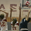 Topsfield: Masco's Kelsey Michaud and Amanda Gotts attempt to block a spike by Peabody's Brianna Waldrop during yesterday's match held at Masconomet Regional High School. <br /> Photo by Deborah Parker/Salem News Friday, September 26, 2008