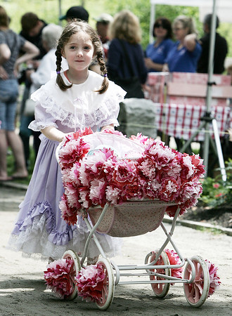 Nelle Higgins,4, of Danvers shows off her carraige to the crowd gathered during Saturday's Doll Carriage Parade at Endicott as part of Endicott Park Day. Photo by Deborah Parker/June 20, 2009