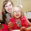 Melissa Fazio of Danvers and her daughter, Isablella, 4, attend the Fancy Nancy Soiree at the Wenham Museum, Tuesday afternoon. Attendees were read a Fancy Nancy story, created a fancy craft and were treated to ice cream. Photo by Deborah Parker/August 24, 2010