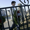 Peabody: Daniel Smith, 10 left, and Jason Margossian, 14, both of Peabody carry wreaths into the Old Burial Ground Saturday morning to place on the graves of five Revolutionary War soldiers. A group of Peabody kids with the help of Gerry Gaetjens, retired USAF, placed wreaths on five graves. <br /> Photo by Deborah Parker/Salem News Saturday, December 13, 2008