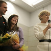 "Danvers: Engaged couple, Hadley von Bruns and Chris Johnson, both of Beverly, were ""ambushed"" with a suprise package called ""An Evening to Remember"" featuring gifts from local businesses while helping to wrap presents for Operation Troop Support at Holton Richmond Middle School Saturday. Here, the couple reaacts after Jeanne Hennessey of Lorraine Roy reveals one of the gifts in the package. Chris, who has been serving in Iraq with the Marines since Janurary of this year, returned home for a 19-day leave. Chris will return to finish his tour next week. <br /> Photo by Deborah Parker/Salem News Saturday, November 15, 2008"
