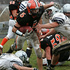 Ipswich's Nathaniel Bocko pushes his way through the Hamilton-Wenham defense during their Thanksgiving football game held at Ipswich HIgh School. Photo by Deborah Parker/November 26, 2009