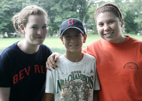From left, counselor in training, Katie Lane, 14, camp attendee Tommy Adams, 10, and counselor Jackie Robichaud, 20, all of Beverly pose together while at Heller-Hubis Park in Beverly as part of the Beverly Recreation Department Parks Program. Photo by Deborah Parker/July 21, 2009