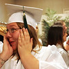 Salem Academy Charter School senior Samantha Bagley jokes around with a friend before the start of the graduation ceremony held at the Salem Waterfront Hotel in Salem Friday evening. Photo by Deborah Parker/June 18, 2010