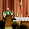 Father Herbert Jones leads mass at the Carmelite Chapel-in-the-Mall at the North Shore Mall Tuesday afternoon. Photo by Deborah Parker/October 27, 2009