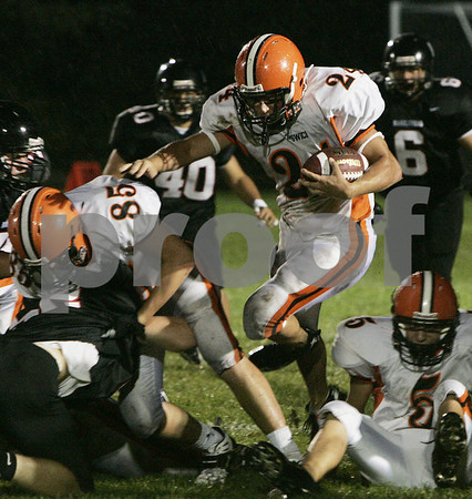 Marblehead:Ipswich's Jim Cadogan makes his way through Marblehead's defensive line during last night's first season game held at Marblehead High School. <br /> Photo by Deborah Parker/Salem News Friday, September 12, 2008