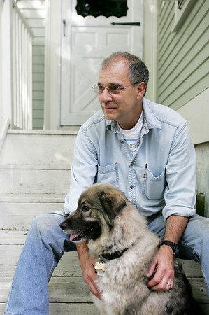 Paul Konstadt sits on his back steps with his dog Penny, at this Salem home Monday afternoon. Konstadt was our barbecuing recently when he was charged by a rabid groundhog. Penny eventually killed the  groundhog. photo by deborah parker/june 14, 2010