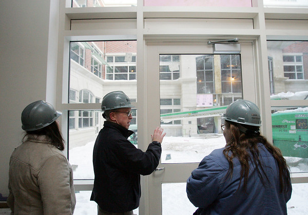 School Committee President Annemarie Cesa, left, and culinary arts teacher Sue Pitman, listen as Superintendent Jim Hays gives a tour of Pitman's new room in the new Beverly High School. Photo by Deborah Parker/January 12, 2009