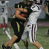 Bishop Fenwick's Jake Bulger is defended by Weston's Gregory Lanzillo during Thursday night's game held at Bishop Fenwick High School in Peabody. Photo by Deborah Parker/September 16, 2010