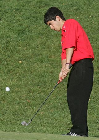 Masconomet golfer Alex Kane competes in yesterday's match at the Turner Hill golf course. Photo by Deborah Parker/October 8, 2009