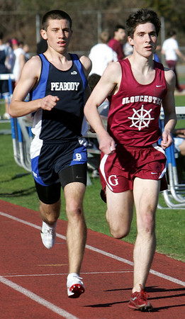 Peabody's Evan Braz and Gloucester' Andrew Ryna compete in the 1 mile during yesterday's meet held at Peabody High School. Photo by Deborah Parker/April 5, 2010