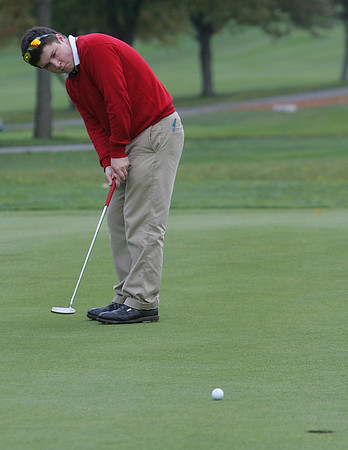 St. John's Nick Maccario puts on the third hole during yesterday's match against Masconomet held at Kernwood Country Club. Photo by Deborah Parker/October 21, 2009