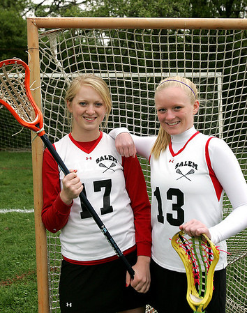 Audrey and Sophie Wyke are sisters who play lacrosse for Salem High. Sophie, a sophomore, set the new single-season scoring record thanks to an assist from Audrey, who is a senior. Audrey has set up Sophie for many goals this season. Photo by Deborah Parker/May 12, 2010