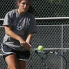 Swampscott's Jen Cleary competes in first singles in yesterday's tennis match against Peabody held in Peabody. Photo by Deborah Parker/May 21, 2010