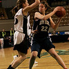 Worcester: Swampscott's Allie Beaulieu is defended by Quaboag's Olivia Jankins in front of the hoop during Saturday's State Finals game held at the DCU Center in Worcester. Photo by Deborah Parker/Salem News Saturday March 14, 2009.
