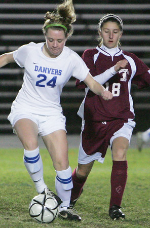 Danvers' Becky Landers and Gloucester's Katie Ciaramitaro fight for control of the ball during Monday night's game held at Danvers High School. Photo by Deborah Parker/November 2, 2009