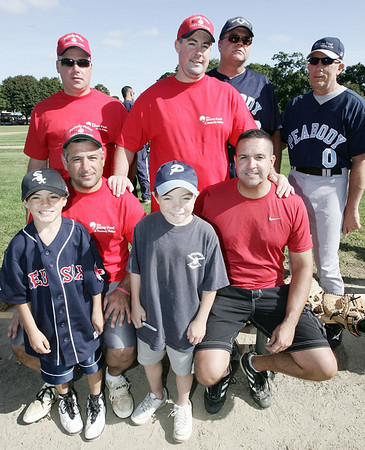 Members of the Peabody Police Department pose together before the start of the North Shore Oldtimers againts Peabody Police Department baseball game to benefit Jimmy Fund. From left, front row, Nick Ricci and Eric Ricci along with Tyler Conrad and Mike Muse. From left, back row, Billy Cook, Rich O'Brien, PJ Eagan and Andy Sweeter. Photo by Deborah Parker/September 7, 2009