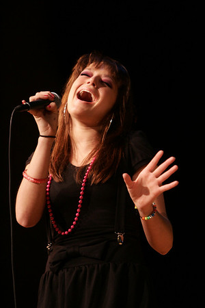 """Melissa Mills, 17, of Peabody performs """"At Last"""" by Etta James during a preliminary round of Danvers Idol held at the Holton Richmond Middle School Tuesday evening as part of Danvers Family Festival. Photo by Deborah Parker/June 30, 2009"""