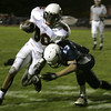Peabody:Beverly's Rashad Sims is brough down by Peabody's ( #17 is not on roster) during their game Friday night.<br /> Photo by Deborah Parker/Salem News Friday, October 10, 2008