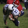 Masconomet's George Alexandrou takcles Triton's Brendan O'Neil during Friday night's game at Masconomet. Photo by Deborah Parker/October 23, 2009