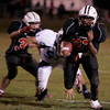 Salem: Salem's Davis Kendrick outruns Peabody's Mike DiFrancisco during Saturday night's game at Bertram Field. Photo by Deborah Parker/Salem News Saturday, November 1, 2008.