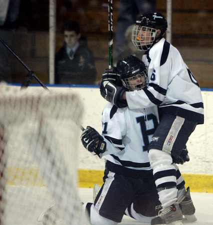 Salem: Peabody's Connor Purcell is hugged by teammate Dave Osgood after Peabody scored against Lincoln-Sudbury in their state tournament game in Division 2 North quarterfinals held at Salem State Friday. Photo by Deborah Parker/Salem News Friday February 27, 2009.