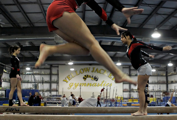 Middleton: (For Salem ROP) From left, Salem High School gymnasts, Amy Burke, Jessica Iwanicki, and Lylybell Piria practice before the start of their meet held at Yellow Jackets in Middleton Saturday evening. Photo by Deborah Parker/Salem News Saturday, January 17, 2009.