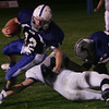 Danvers' Greg Ladd is brought down by Lynnfield's Freddy Shove during last night's game held at Deering Field. Photo by Deborah Parker/October 9, 2009