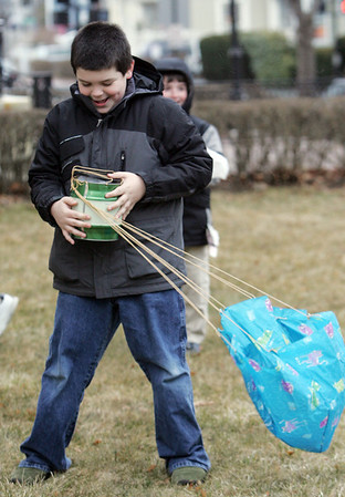 Harrison Palmer, 10, of Beverly looks inside his can that was dropped off the top of the Beverly Public Library to see if the egg inside was still in tact. The experiment was part of the Astronomy Club, an afterschool program at the library for grade school students, where they can learn about Outer Space and the United States Space program. The program was lead by assistant Children's librarian LInda Furey. Photo by Deborah Parker/March 3, 2010.<br /> m, Harrison Palmer, 10, of Beverly looks inside his can that was dropped off the top of the Beverly Public Library to see if the egg inside was still in tact. The experiment was part of the Astronomy Club, an afterschool program at the library for grade school students, where they can learn about Outer Space and the United States Space program. The program was lead by assistant Children's librarian LInda Furey. Photo by Deborah Parker/March 3, 2010.<br /> m