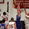 Danvers' Nick Strangie is defended in front of the hoop by Salem's Derek McIntyre and Antonio Reyes durng last night's game held at Salem High School. Photo by Deborah Parker/January 25, 2009