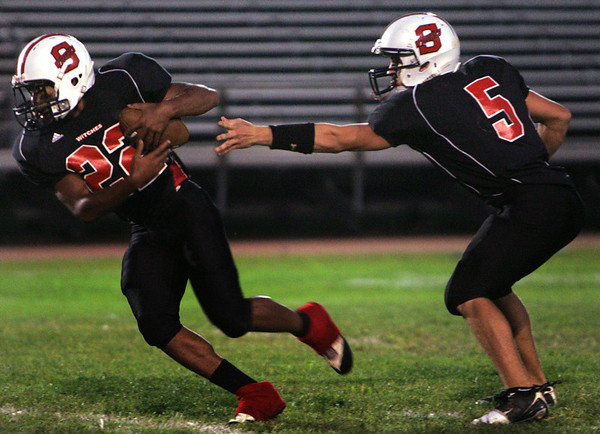 Salem's Brad Skeffington passes the ball off to David Kendrick during Friday night's game against Bishop Fenwick held at Bertram Field. Photo by Deborah Parker/September 18, 2009