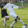 Hamilton-Wenham's Ben Chumara keeps the ball from Lynnfield's Connor Dario during yesterday's game in Hamilton. Photo by Deborah Parker/October 8, 2009