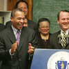 Governor Deval Patrick laughs along with Lt. Governor Tim Murray during a press conference at Essex Agricultural and Technical High School after a bird clock chirpped the time in the middle of the conference Friday morning. Photo by Deborah Parker/December 11, 2009