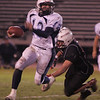 Salem: Peabody's Tom Ciulla escpaes a tackle by Salem's  James Lobao during Saturday night's game at Bertram Field. Photo by Deborah Parker/Salem News Saturday, November 1, 2008.