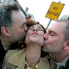 Salem: Richard Flynn, Jill Duforf, and Steve Koster, all of Salem steal a kiss outside of In A Pig's Eye near the No Busses sign. Photo by Deborah Parker/Salem News Friday March 6, 2009.