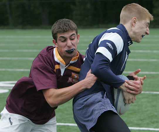 St. John's Matt Smerczynski is tackled by Boston College High's Mike Nader during yesterday's rugby match held at St. John's Prep. Photo by Deborah Parker/May 18, 2010