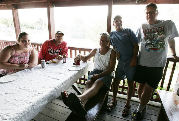 From left, Courtney Krenzel of Beverly Chris Connellly, Stephen Foster, Chris Candelaria and Eddie Lubas, all of Salem, attend the Salem Witch City Post 1524, VFW, barbeque held at Camp Naumkeag Saturday. Photo by Deborah Parker/August 22, 2009